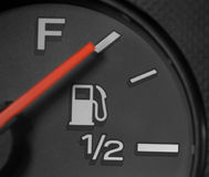 Full Fuel Gauge. A gasoline gauge on a car shows a full tank. Perfect Stock Images
