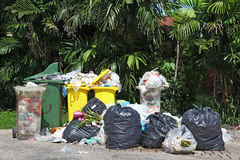 Full garbage bin. Overload of Full garbage trash bin or containers Royalty Free Stock Photography
