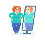Full girl looks in the mirror, wanting to lose weight. Royalty Free Stock Images