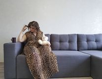 Full girl the sofa teddy bear toy sweetheart emotions holding relax royalty free stock photos