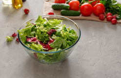 Full glass bowl of fresh green salad Stock Photo