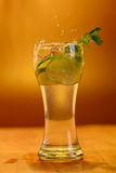 Full glass of fresh cool tonic with lime fruits Royalty Free Stock Images
