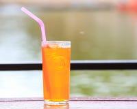 Full glass of fresh iced orange juice Royalty Free Stock Photos