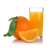 Full glass of fresh orange juice and fruit Stock Image