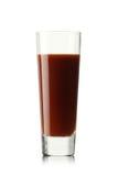 full glass fruktsafttomat Arkivbild