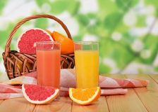 Full glass of grapefruit and orange juice Royalty Free Stock Photo
