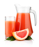 Full glass and jug of grapefruit juice and fruits Royalty Free Stock Image