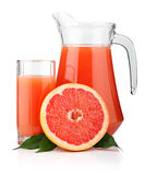 Full glass and jug of grapefruit juice isolated Stock Photo