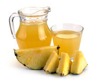 Full glass and jug of pineapple juice Royalty Free Stock Images