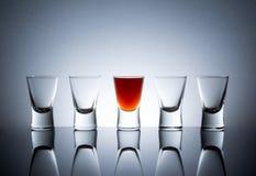 Full Glass Near Empty Glasses Royalty Free Stock Photography