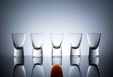 Full Glass Near Empty Glasses Stock Image