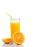 Full glass of orange juice with straw near half orange with space for text Royalty Free Stock Images
