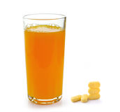 Full glass of orange juice and Vitamin C pills Stock Photography