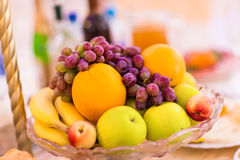 Full glass vase of ripe tasty fruit Royalty Free Stock Images