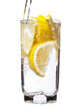 Full glass of water with lemon isolated Royalty Free Stock Photo