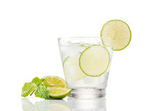 Full glass of water with lemon and mint isolated on white background Royalty Free Stock Photo
