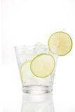 Full glass of water with lemon and mint isolated on white background Stock Photo