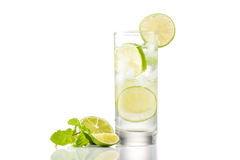 Full glass of water with lemon and mint isolated on white background Royalty Free Stock Photos