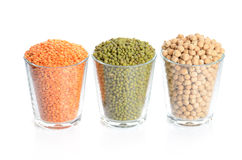Full glasses with mung, lentil and chick-pea Stock Photos