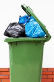 Full green dustbin Royalty Free Stock Image