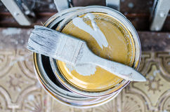 Full of grey paint tin and Old used paintbrushes on it,  Stock Photo