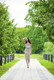 Full growth, beautiful young woman in sexy long gray dress Stock Photos
