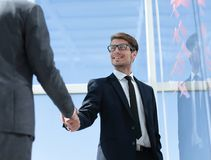 In full growth. business partners handshake stock photography