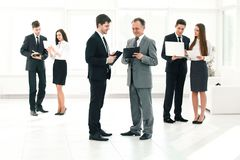 Company`s employees are preparing to start a business meeting. royalty free stock photo