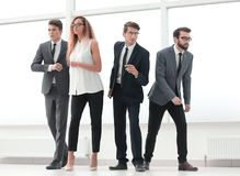 In full growth.a group of young entrepreneurs standing in a brig stock image