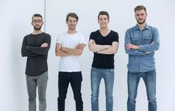 Group of young men in casual clothes stock photo
