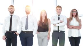 In full growth.modern business team standing in a bright office. The concept of professionalism royalty free stock images