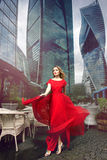 Full growth portrait of fashionable woman on urban background Stock Photo