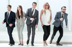 In full growth. professional business team stepping together. The concept of a startup stock image