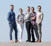 In full growth.a team of creative young people royalty free stock images