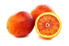 Full and half of blood red oranges. Stock Images