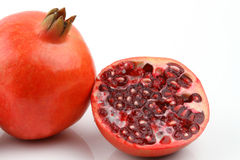 full and half cut red pomegranate Stock Photos