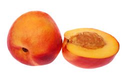 Full and half nectarine on white Royalty Free Stock Photos