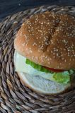 Full hamburguer on rustic background