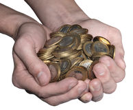 Full handful of coins Stock Photography