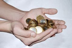 Full handful of coins Stock Image