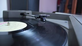 Record player head parking after ending the vinyl. Full hd video of a record player head parking after ending the vinyl playing session stock footage