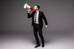 Full height Business man screaming with a megaphone Stock Photography