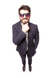 Full height Confident young handsome man in sunglasses hand on chin Royalty Free Stock Photo