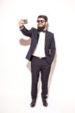 Full height handsome young hipster man in suit and sunglasses making selfie Royalty Free Stock Photo