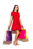 Full height woman with color shoping bags in hands on white background Stock Image