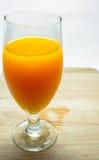 Full high glass of orange juice Stock Image