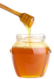 Full honey pot and dipper Royalty Free Stock Image