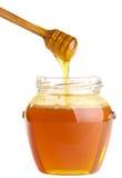 Full honey pot and dipper royalty free stock image