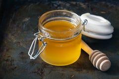 Full honey pot and honey stick Stock Photo