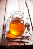 Full honey pot and honey stick Stock Images